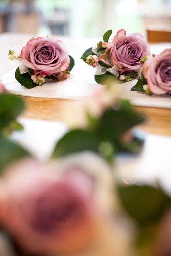 Vintage style buttonholes, dusky pink roses