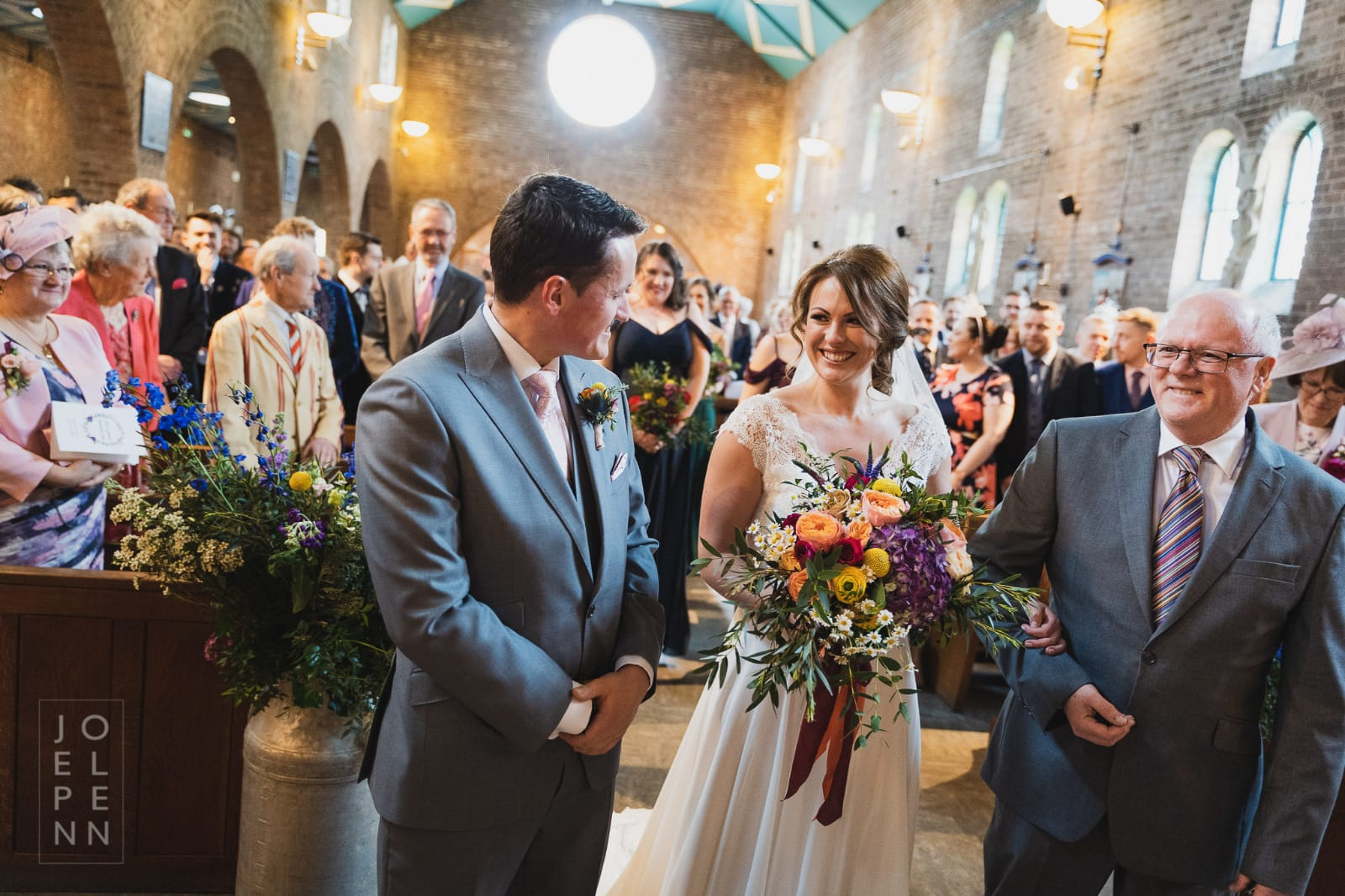 happy couple getting married in a church with bridal flowers