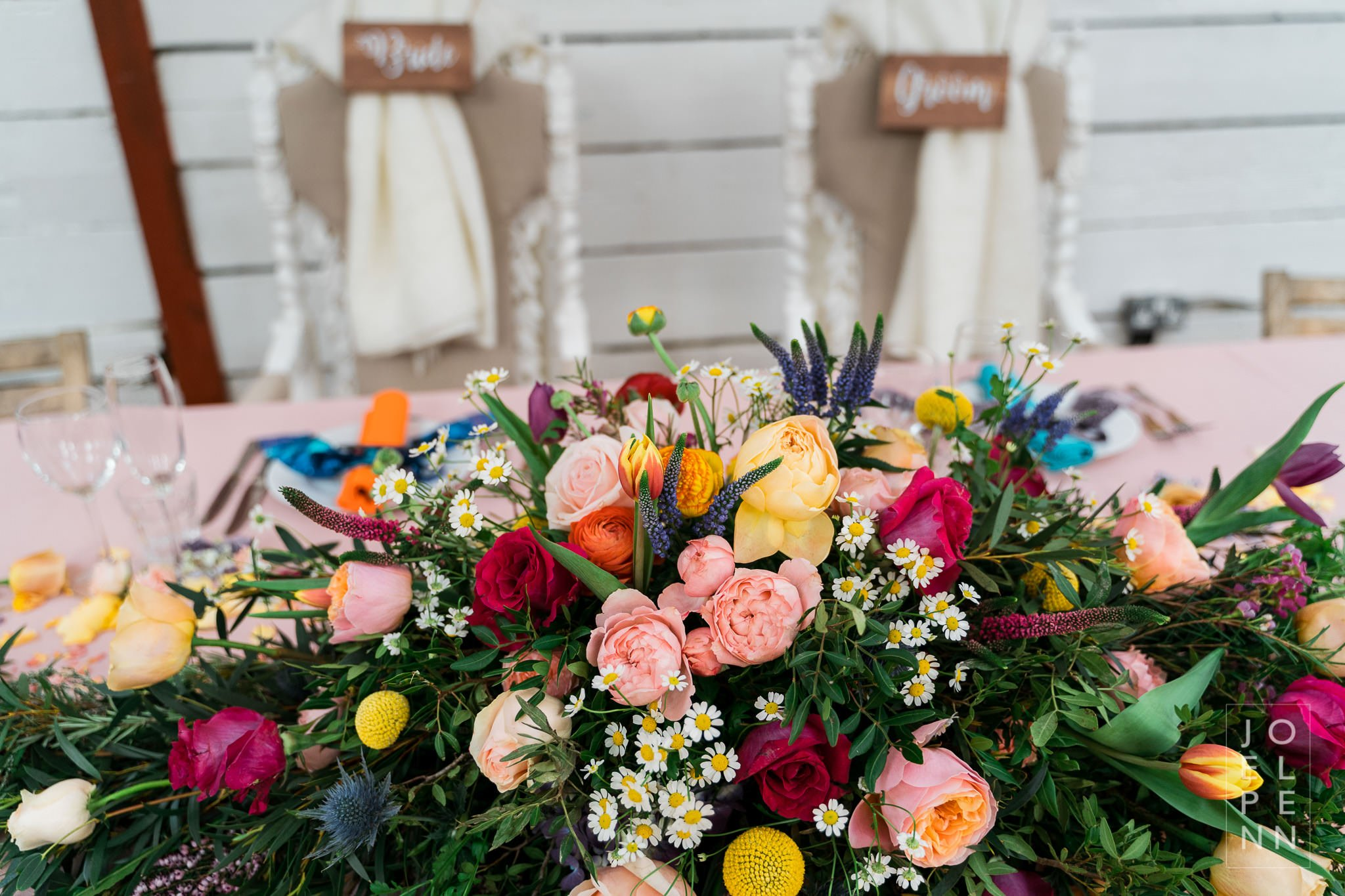 Bright colourful floral top table arrangement at wellbeing farm