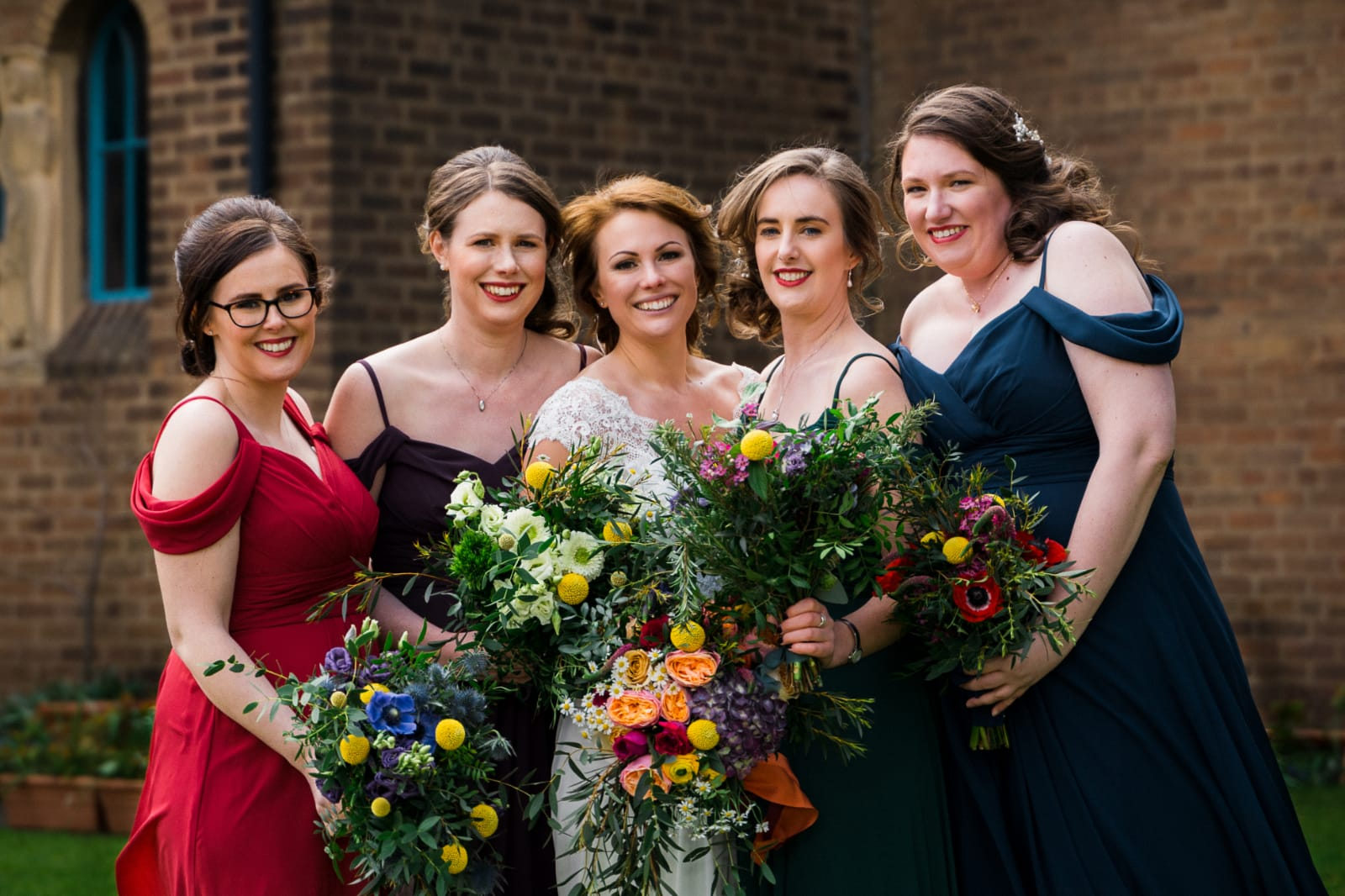 Bride with her bridesmaids, colourful wedding