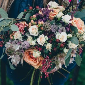 Autumnal bouquet filled with textures, roses and berries