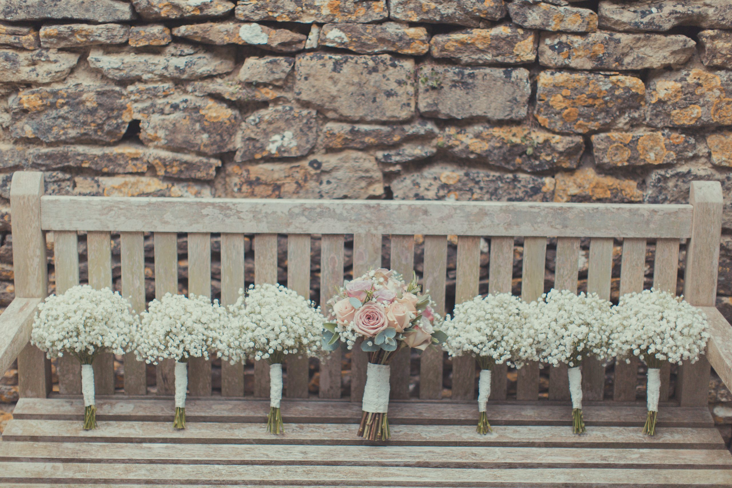 Vintage bride and bridesmaids bouquet on a bench