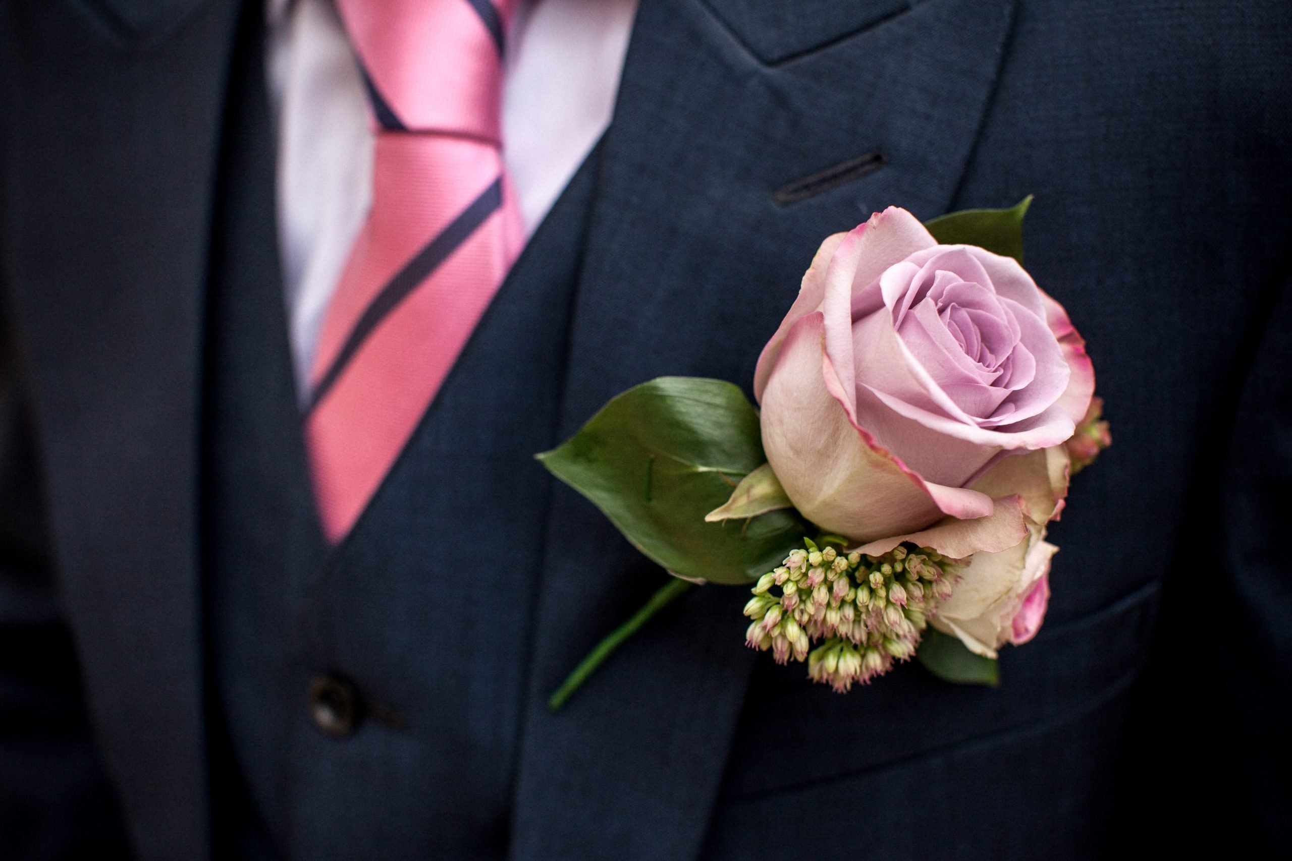 Grooms buttonhole, memory lane rose with snowberries