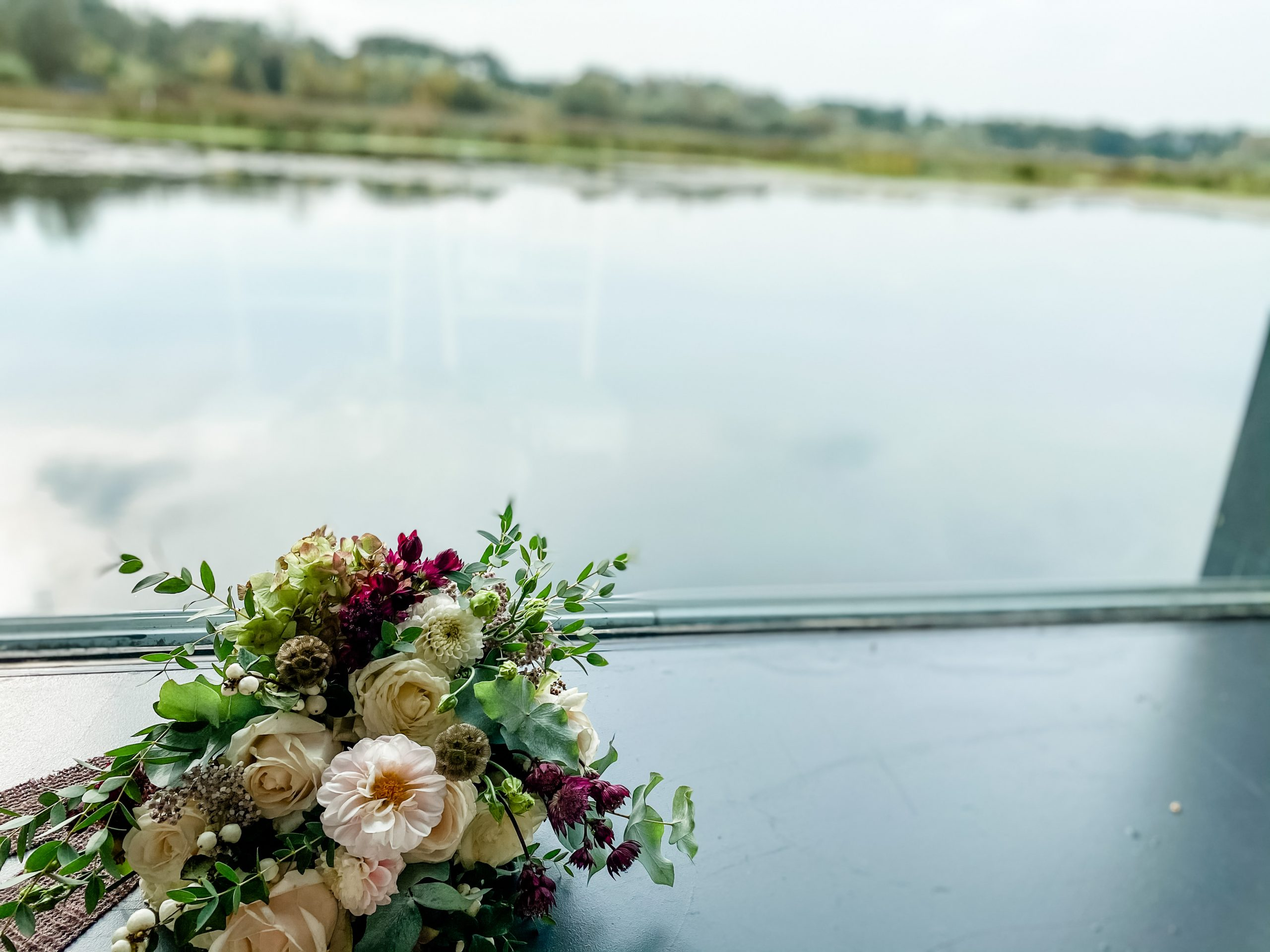 Bridal bouquet overlooking the water at brockholes