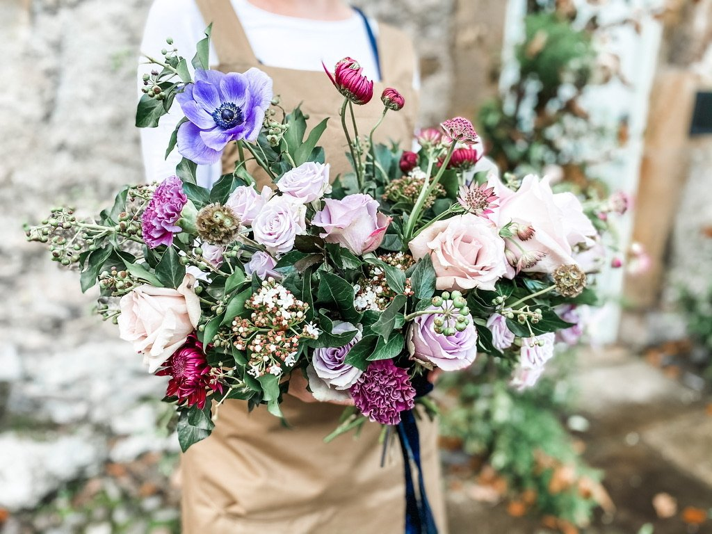 Rustic bridal bouquet, soft pinks, purples with hints of hot colours