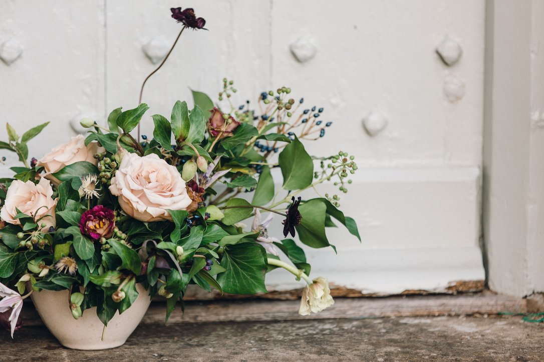 Floral bowl arrangement, soft pinks, berries and chocolate cosmos