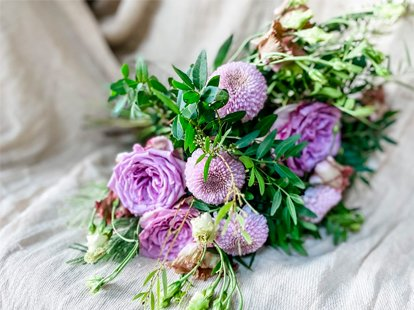 Natural bunch of flowers filled with roses in purple muted tones