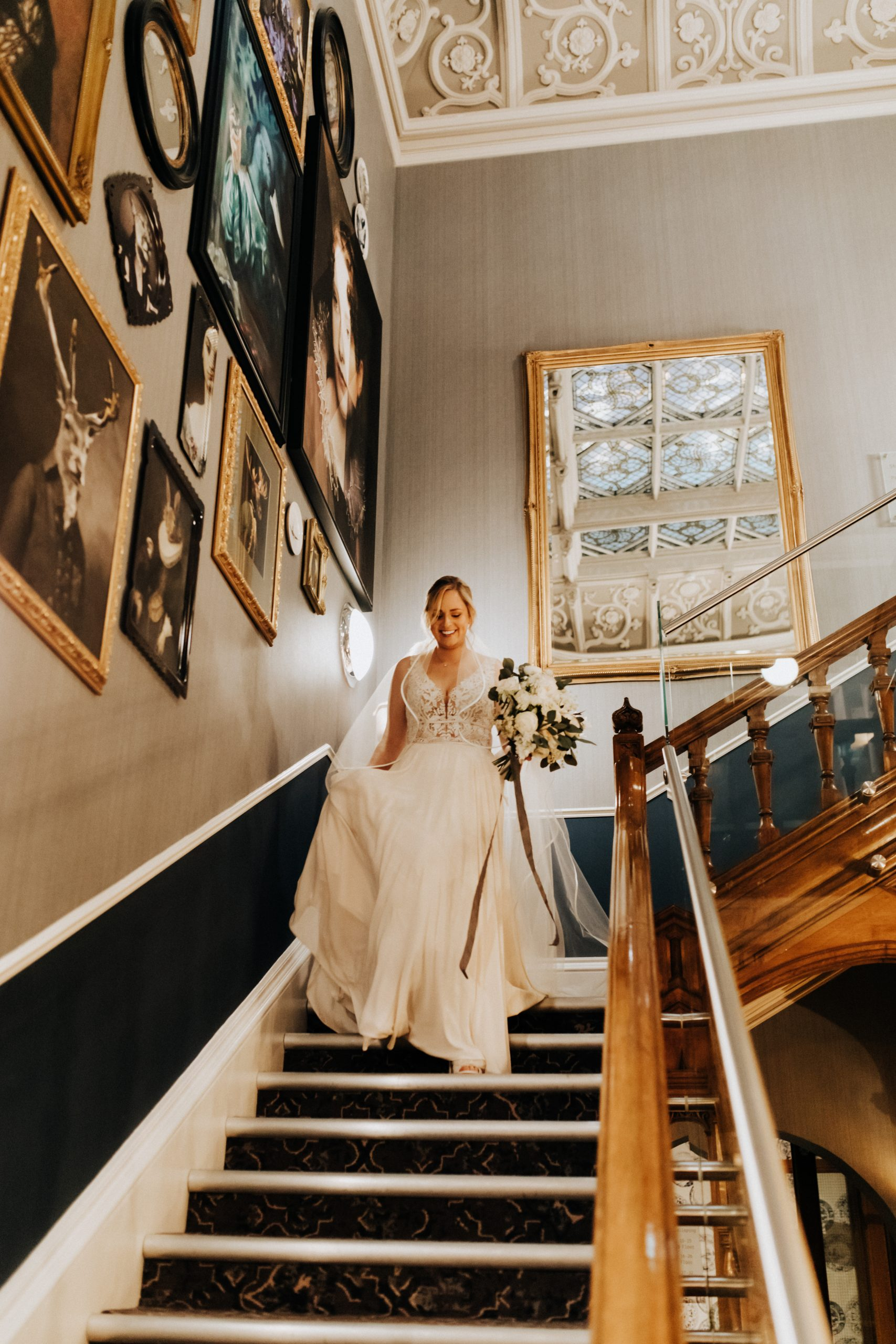 bride walking down grand staircase